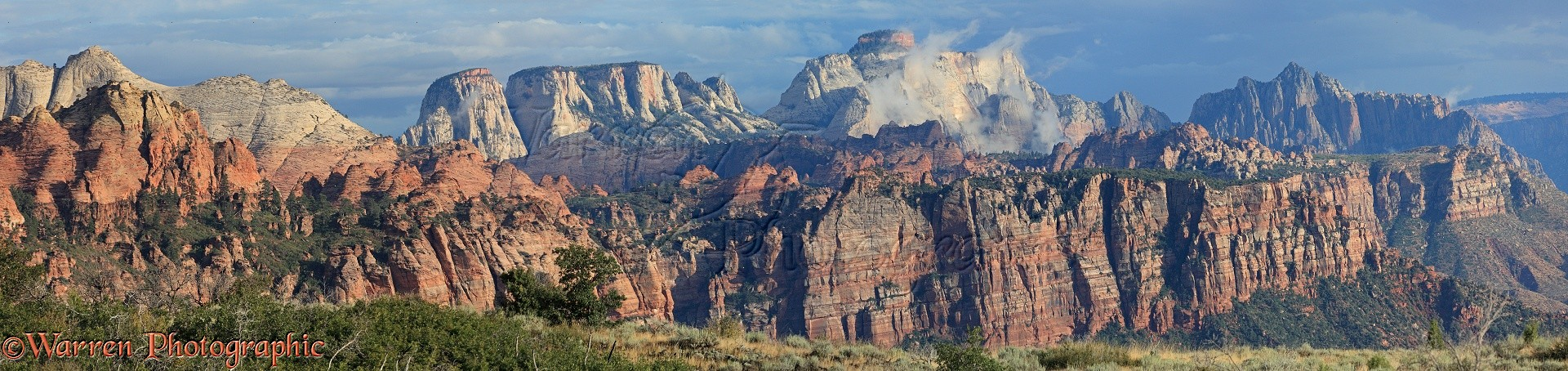 Panoramic Of Rocky Sandstone Mountains And Cliffs Photo