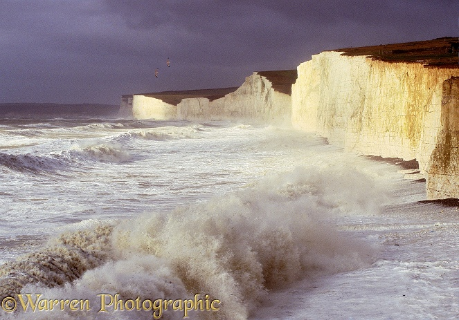 Chalk cliffs being pounded by huge waves whipped up during a winter storm.  Sussex, England