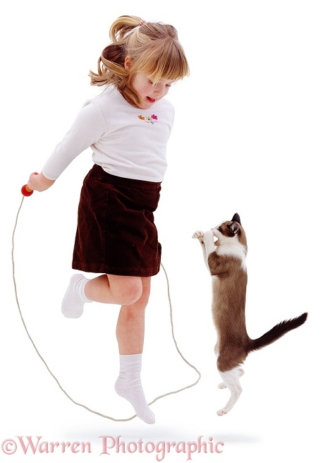 Marcia, 4 years old, skipping with a cat, white background