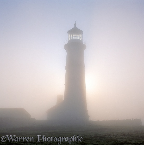 Old Lighthouse with misty atmosphere.  Lundy Island, England