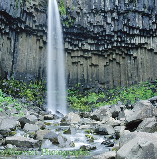 Columnar basalt and waterfall.  Iceland