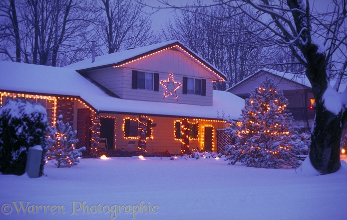 Snowy house with Christmas lights.  British Columbia, Canada