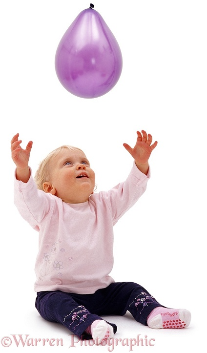 Siena, 13 months old, reaching up for a balloon, white background