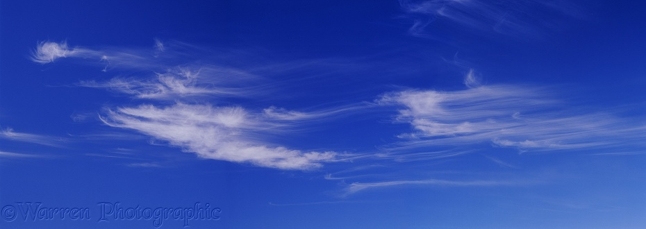 Blue sky with swirly mare's tail clouds