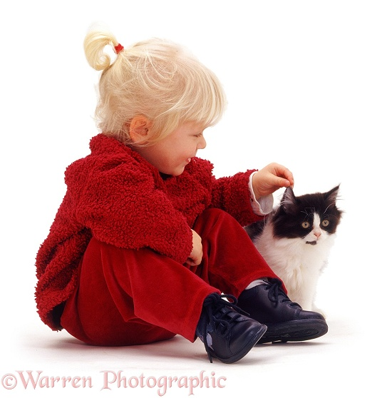 Siena stroking a black-and-white kitten, white background