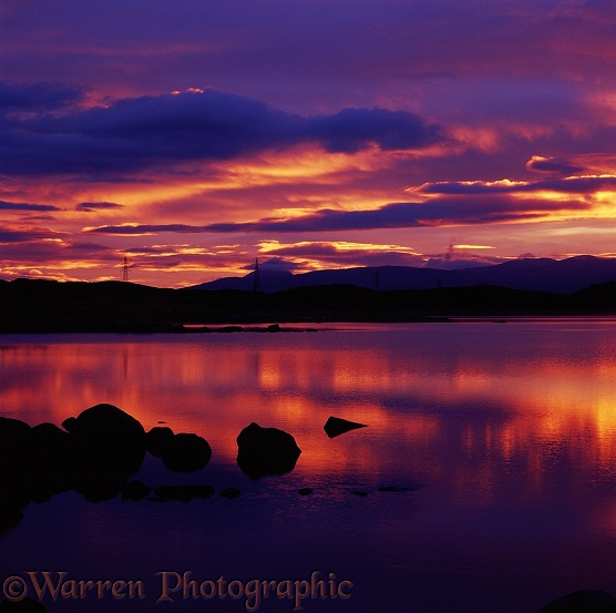 Sunset over lake in Scotland