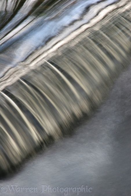 Water going over a small weir.  Surrey, England