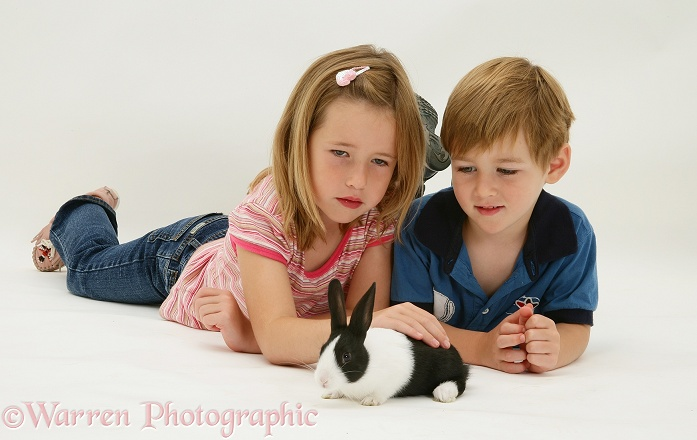 Madison and Jack with a young Dutch rabbit, white background