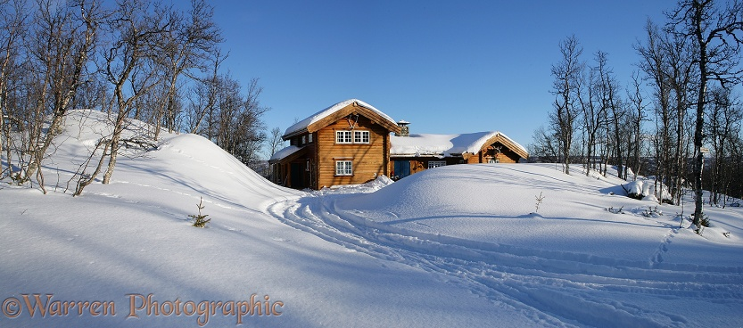 Wooden house with deep snow.  Geilo, Norway