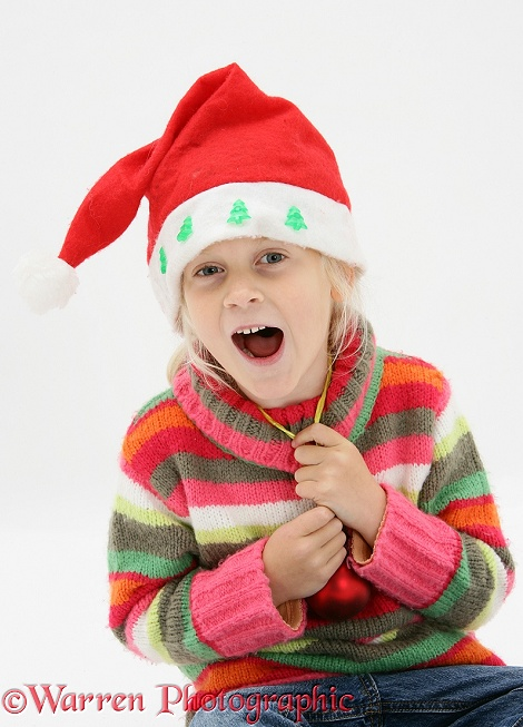 Siena laughing and wearing a Santa hat, white background
