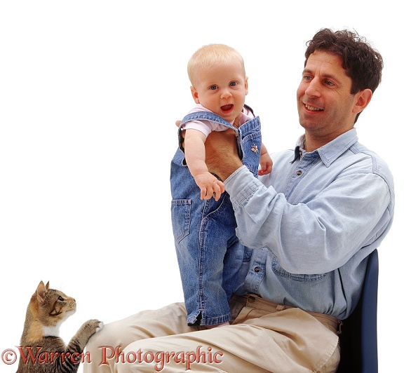 Mark playing with baby Siena, 6 months old, and ignoring the cat, white background
