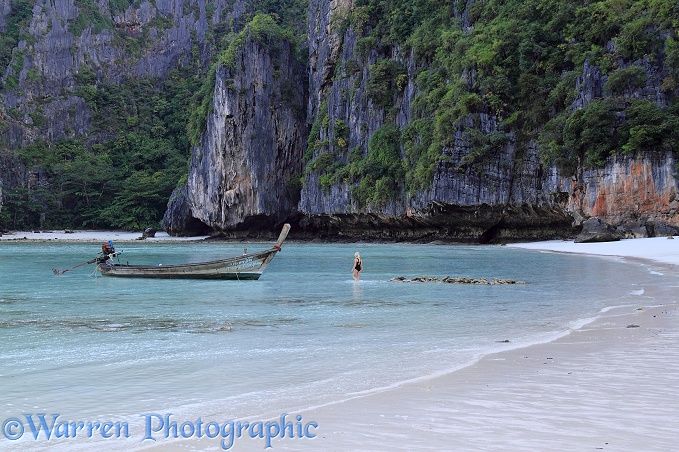Boat and tropical sandy beach.  Koh Phi Phi, Thailand