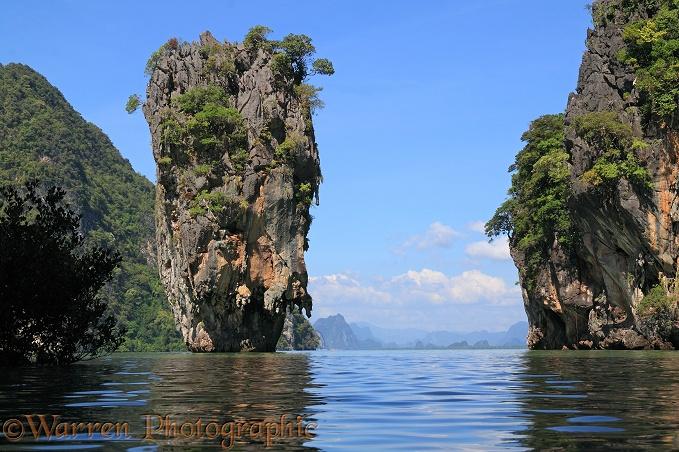 Limestone cliffs and pinnacle islands photo - WP31753