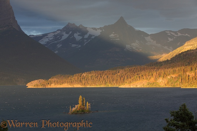 Lake and mountains at sunrise.  Glacier National Park, Montana, USA