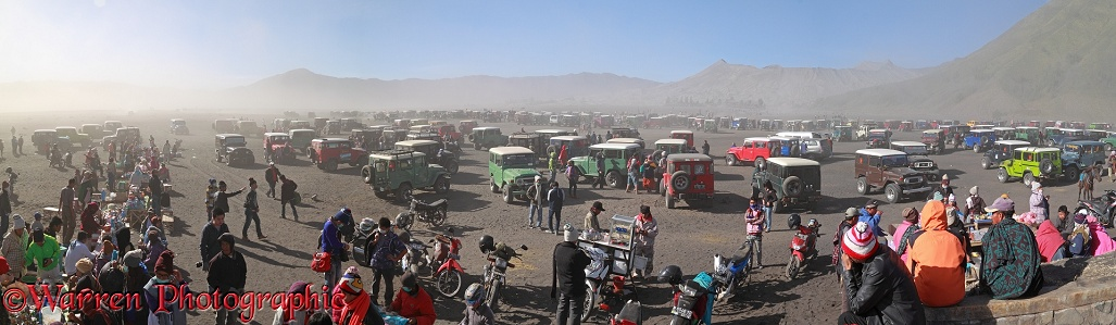 People and jeeps at Mt Bromo panorama.  Indonesia