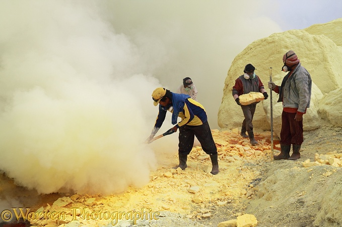 Men working the sulphur mine at Kawah Ijen.  Java, Indonesia