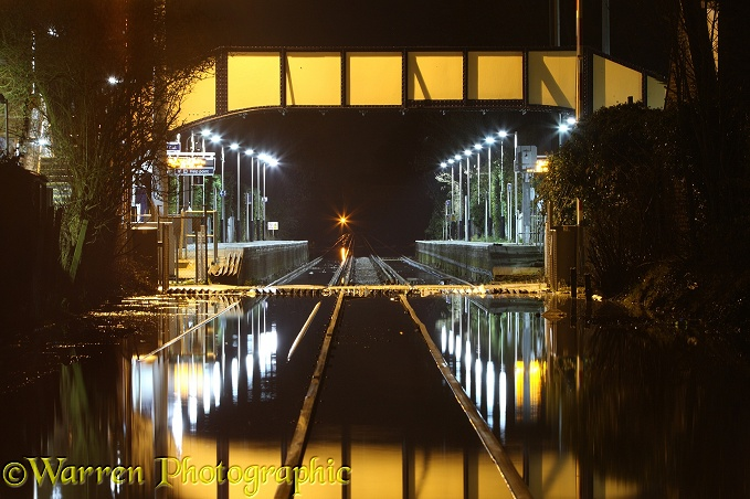 Flooded Datchet railway station, at night. Inundated by water from the River Thames in February 2014.  Berkshire, England