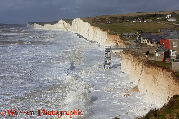 Chalk cliffs being pounded by huge waves whipped up during a winter storm at Birling Gap.  Sussex, England