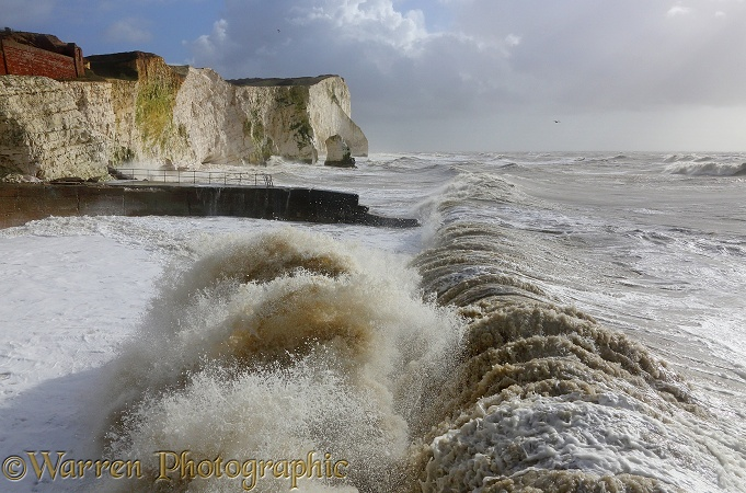 Waves breaking against sea wall and cliffs. Seaford, February 2014.  Sussex, England