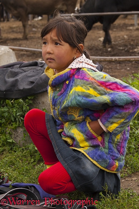 Kyrgyz girl at the Karakol Animal Market.  Kyrgizstan