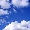 Blue sky with puffy white clouds
