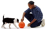 Boy and puppy with a ball