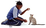 Boy clicker-training a cat