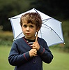 Boy with little umbrella