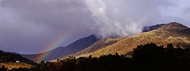 Mountain and clouds with rainbow