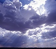 Cloudy sky with sunbeams