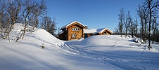Wooden house with deep snow