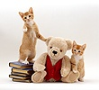 Two ginger kittens with cream Teddy Bear in red waistcoat