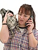 Woman phoning with cat on her shoulder