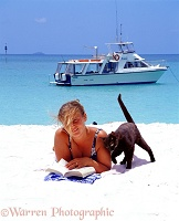Jane on a white sand beach with cat
