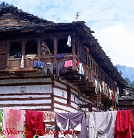 Indian woman at window in Old Manali