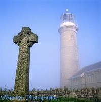Misty Lundy old lighthouse and grave stone