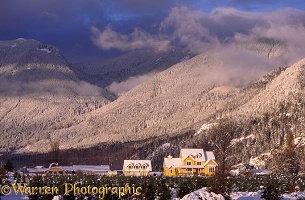 Yellow house in snow scene