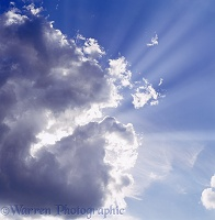 Blue sky and clouds with rays