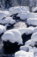 Snow on river boulders