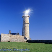 Lundy old lighthouse with sun reflection