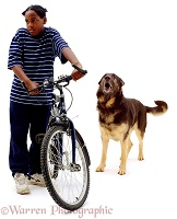 Boy with bike and Alsatian