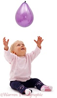 Baby Siena reaching up for a balloon