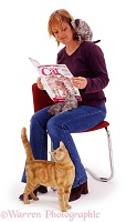 Woman reading Your Cat magazine
