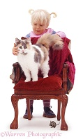Little girl with cat on a chair