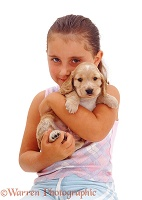 Girl with a Golden Cocker Spaniel puppy