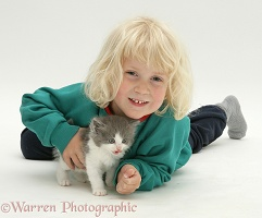 Little girl with grey-and-white kitten