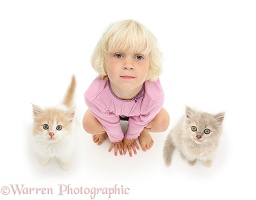 Girl and kittens looking up
