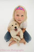 Girl with Golden Retriever pup