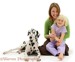 Little girl, lady and Dalmatian