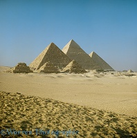 The Pyramids of Giza seen from the desert